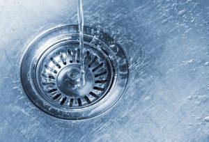 Water running into kitchen sink drain